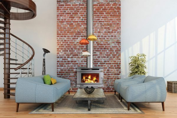 Living room with warm materials and ambiance, sofa and two chairs setup, with coffee table, decoration, plant, pendant lights, in front of a fireplace on a brick wall. There is a staircase, and sun rays falling into the scene. horizontal frame.